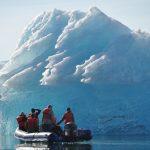 Skiff at an iceberg
