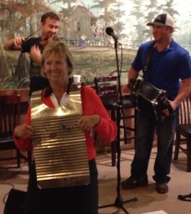 Barb playing Cajun washboard in the Cajun band