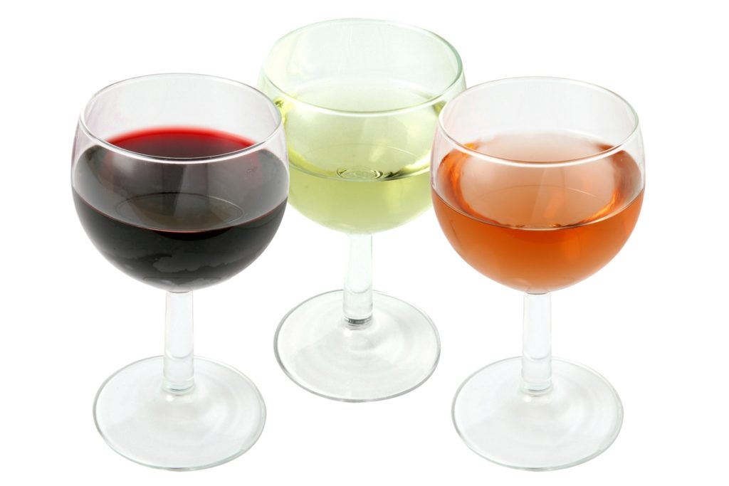A glass of red, white and rose wines