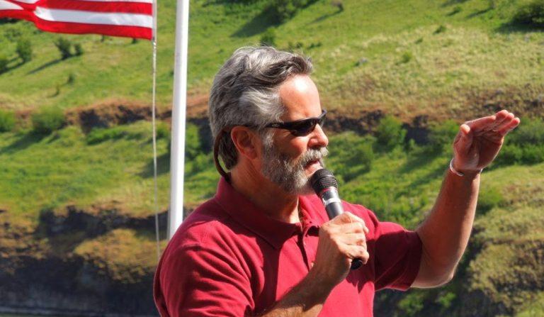 Historian Todd Weber giving a presentation on board a river cruise.