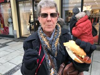 Kathy enjoying a bratwurst at Passau Christmas Market
